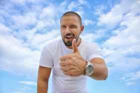 black haired man in white crew neck t shirt